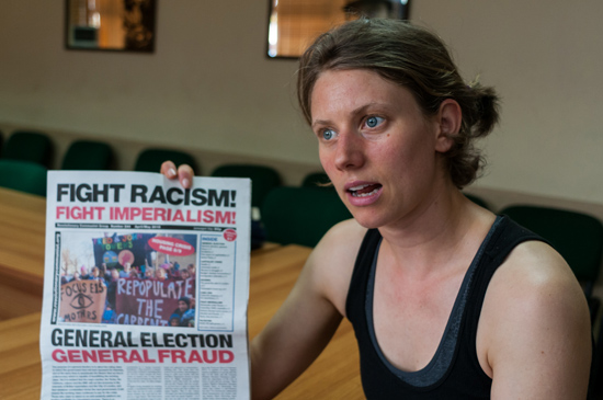 "Samantha explains about the newspaper ""Fight Racism, Fight Imperialism"". Photo: Calixto N. Llanes"