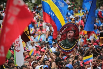 Venezuelans take to the streets to mark the death of Hugo Chavez