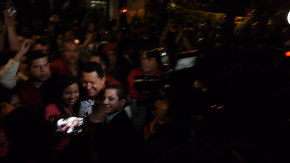Chavez stands for a photo during the unexpected visit